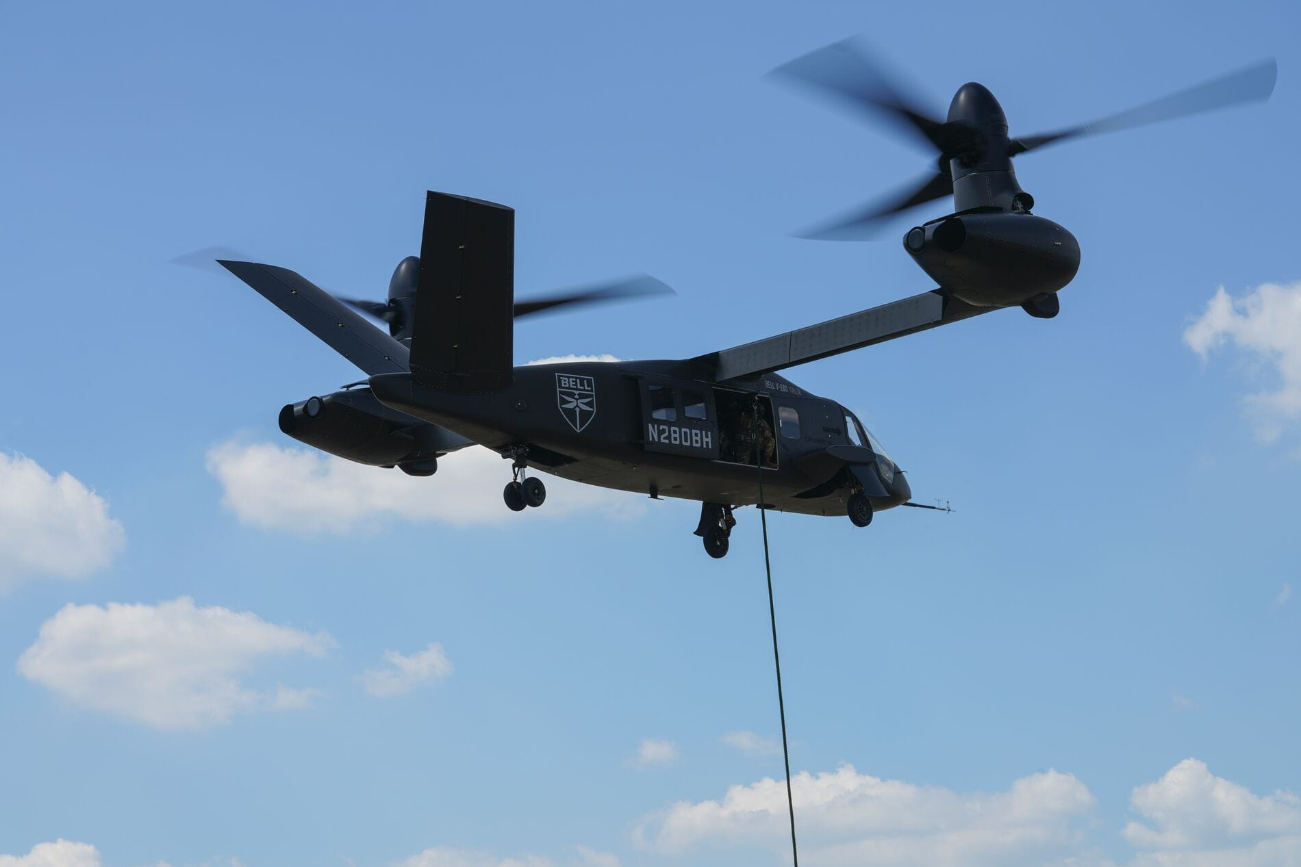 Bell V-280 Valor in flight showing fast rope missions. The Bell V-280 is Bell's entry to the U.S. Army's Future Long Range Assault Aircraft (FLRAA) and Future Vertical Lift (FVL) competition.