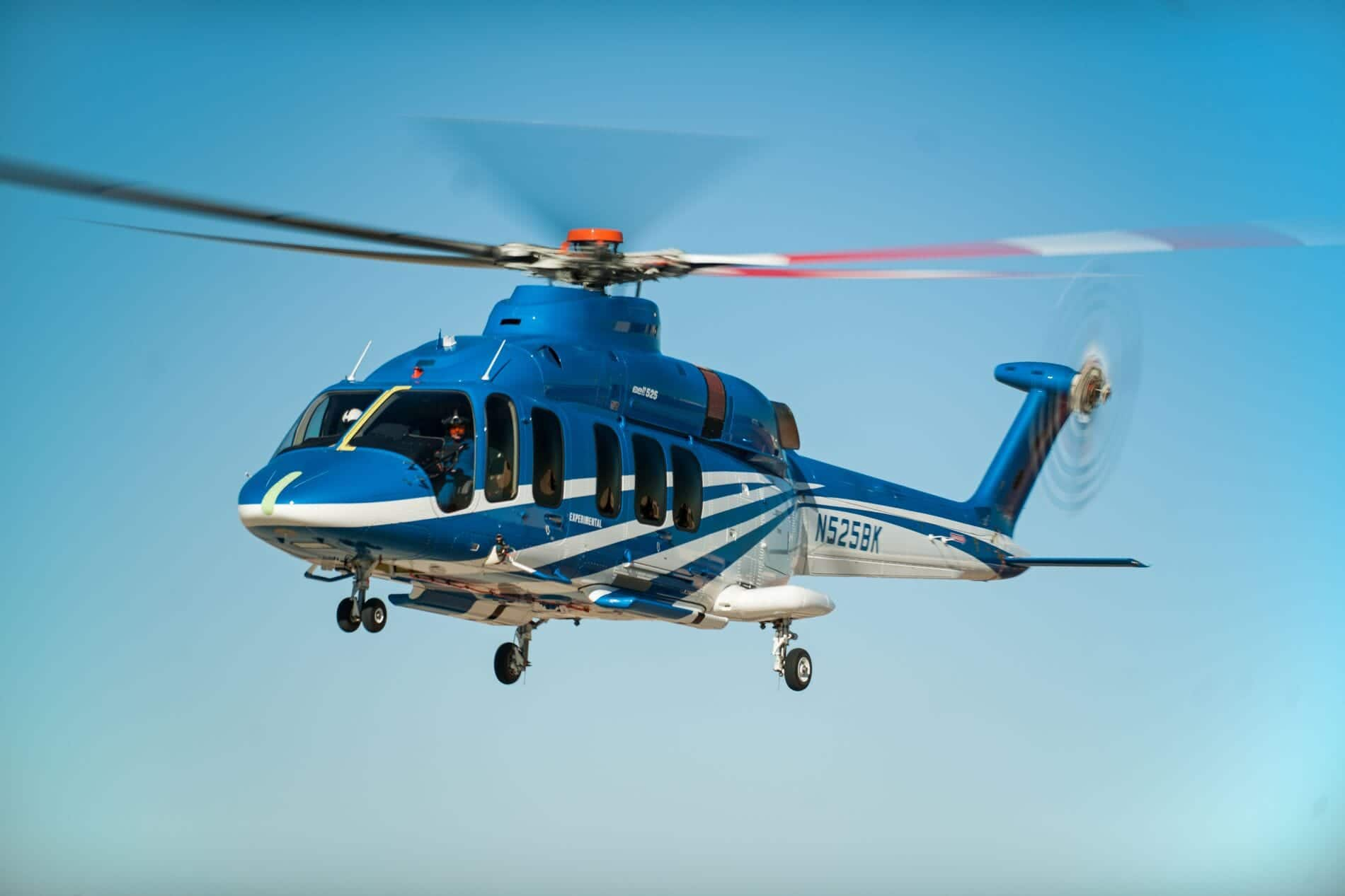 Bell 525 Airborne in Front a Blue Sky