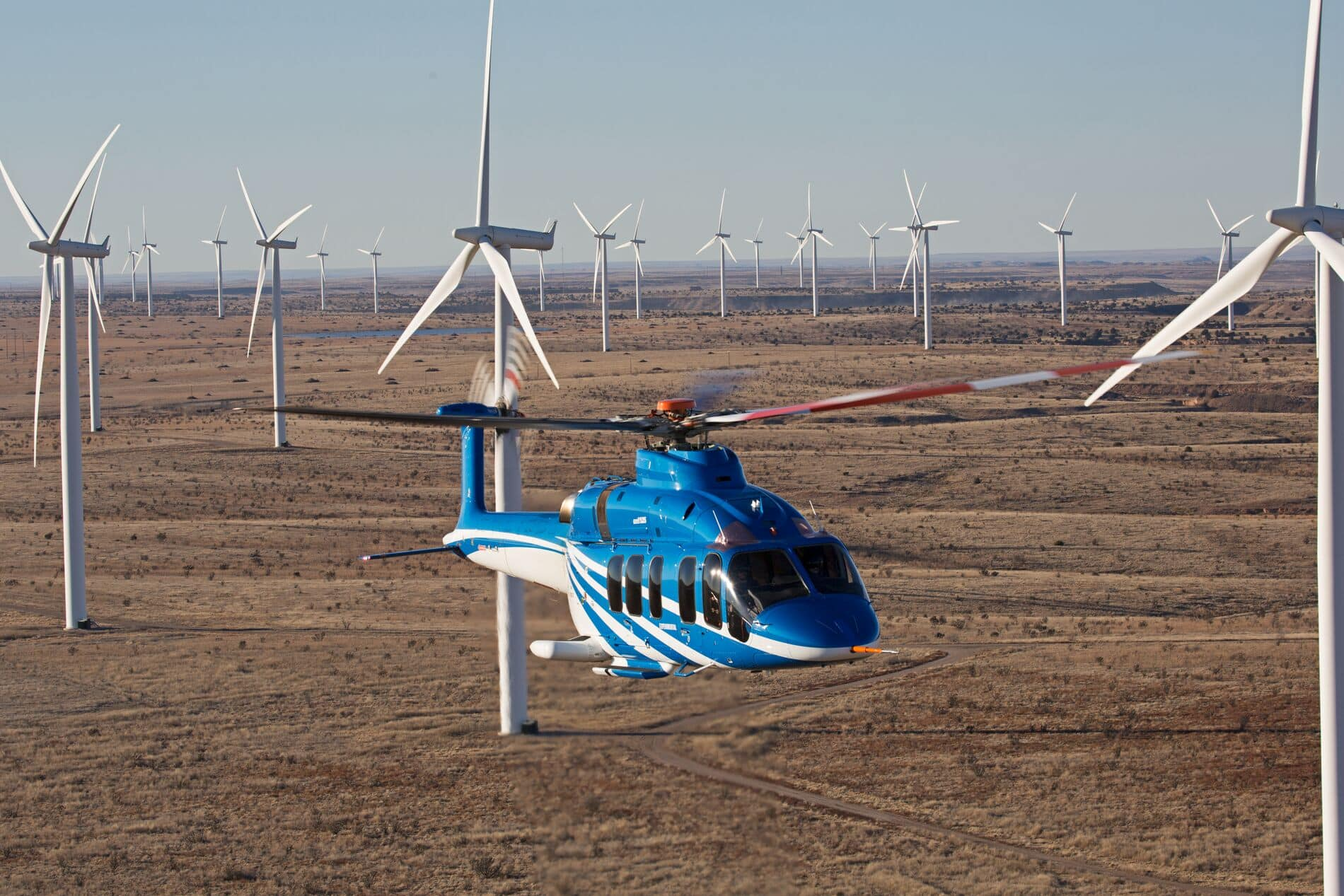 Bell 525 Flying Through Desert Windfarm