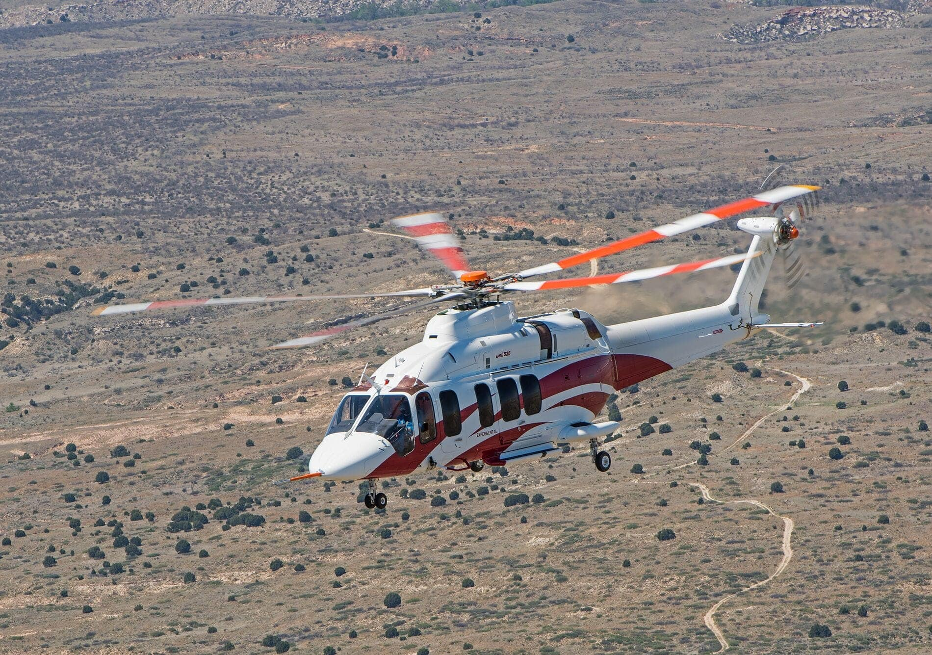 Bell 525 White In Flight Over Desert